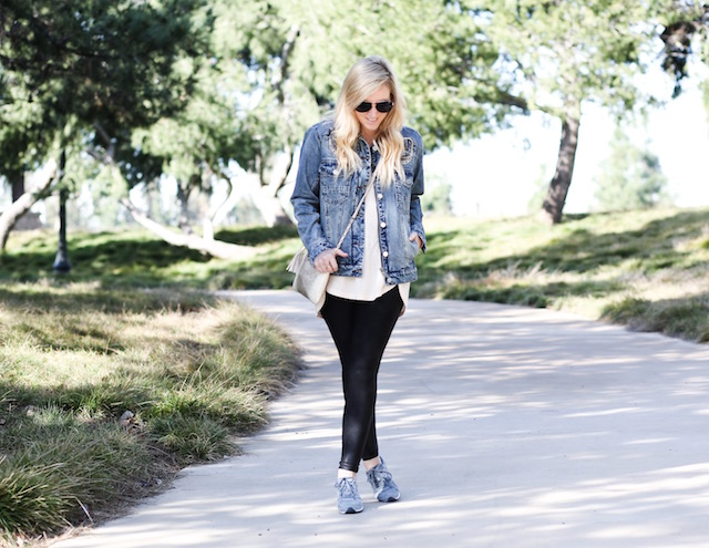 Orange County fashion blogger Nikki Prendergast of My Style Diaries wears a Blank NYC denim jacket, Spanx leggings, and New Balance sneakers.