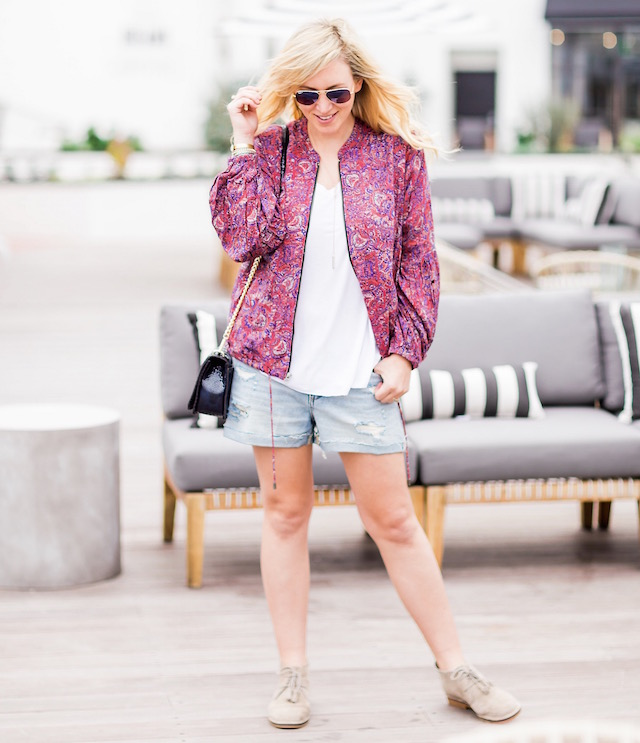 Orange County fashion blogger Nikki Prendergast of My Style Diaries wears denim cutoffs and a Free People spring bomber.