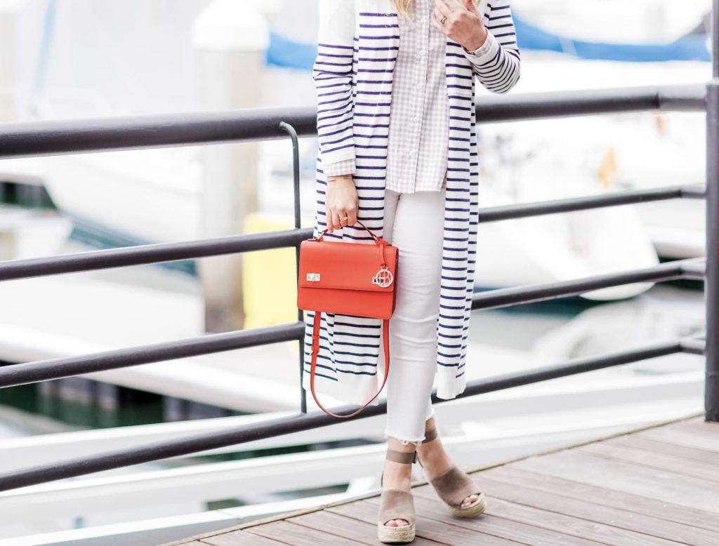 Orange County fashion blogger Nikki Prendergast of My Style Diaries wears an Evy's Tree button-down and cabi cardigan with a Henri Bendel bag and Marc Fisher wedges.