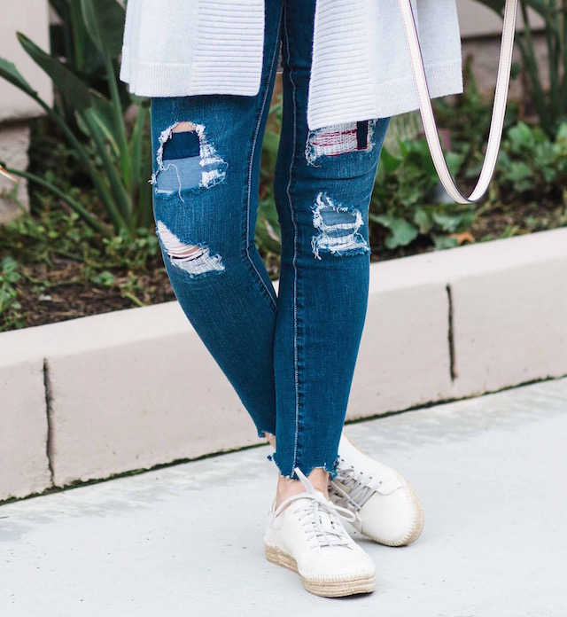 Orange County fashion blogger Nikki Minton Prendergast of My Style Diaries wears affordable distressed denim and Spring sneakers.