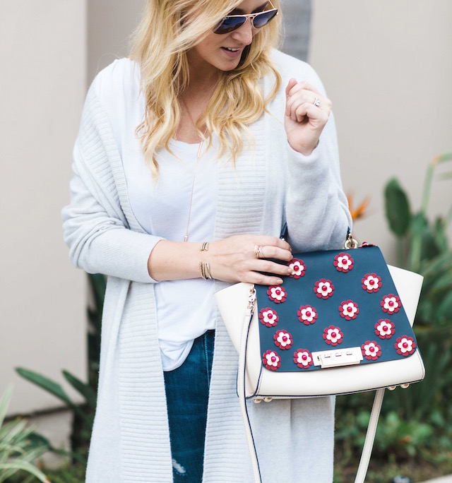 Orange County fashion blogger Nikki Minton Prendergast of My Style Diaries wears affordable distressed denim and Spring sneakers with Zac Zac Posen handbag..