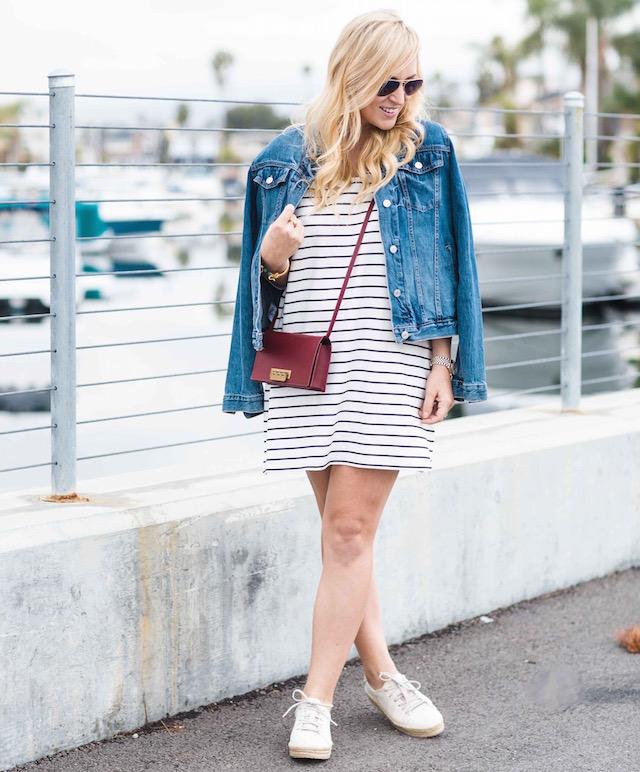 Orange County fashion blogger Nikki Minton Prendergast of My Style Diaries wears a striped t-shirt dress and denim jacket.
