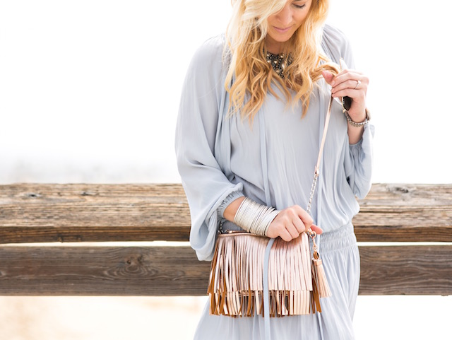 Fashion blogger Nikki Minton of My Style Diaries wearing a Ramy Brook silk dress and fringe handbag for easy Valentine's Day or date night style.