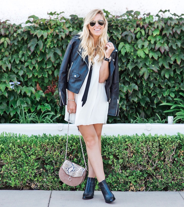 Fashion blogger Nikki Minton of My Style Diaries wearing a tie-neck dress and faux leather jacket for easy date night or Valentine's Day style.