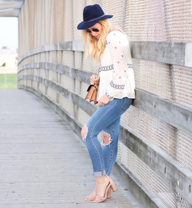 Orange County fashion blogger Nikki Prendergast of My Style Diaries in boyfriend jeans and a boho peasant top.