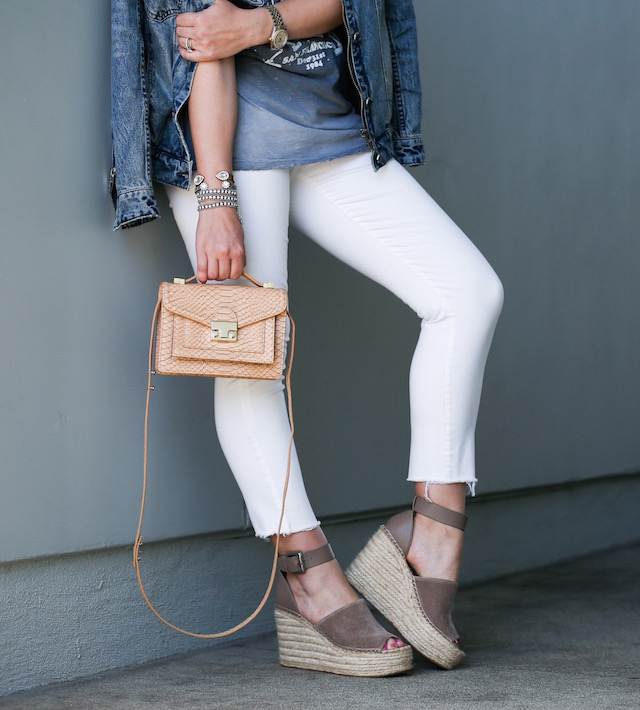Orange County fashion blogger Nikki Prendergast of My Style Diaries wears a Junk Food Clothing tank, white jeans, Loeffler Randall handbag, Marc Fisher wedges, for festival season style.