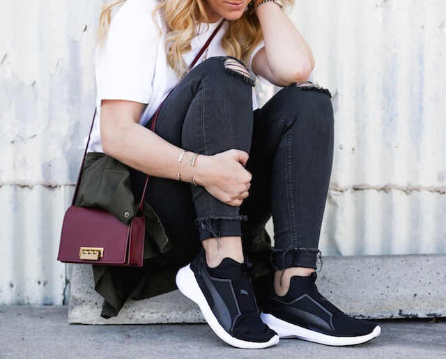 Orange County fashion blogger Nikki Prendergast of My Style Diaries wears Hudson jeans and Puma Rebel sneakers.