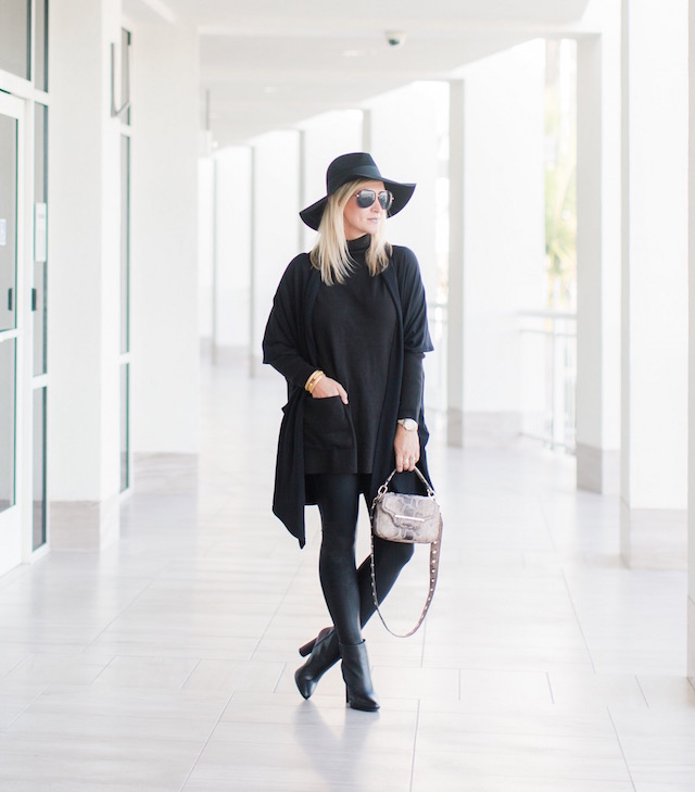Fashion blogger Nikki Prendergast of My Style Diaries in Spanx leggings, cabi turtleneck and booties, and a Henri Bendel handbag.