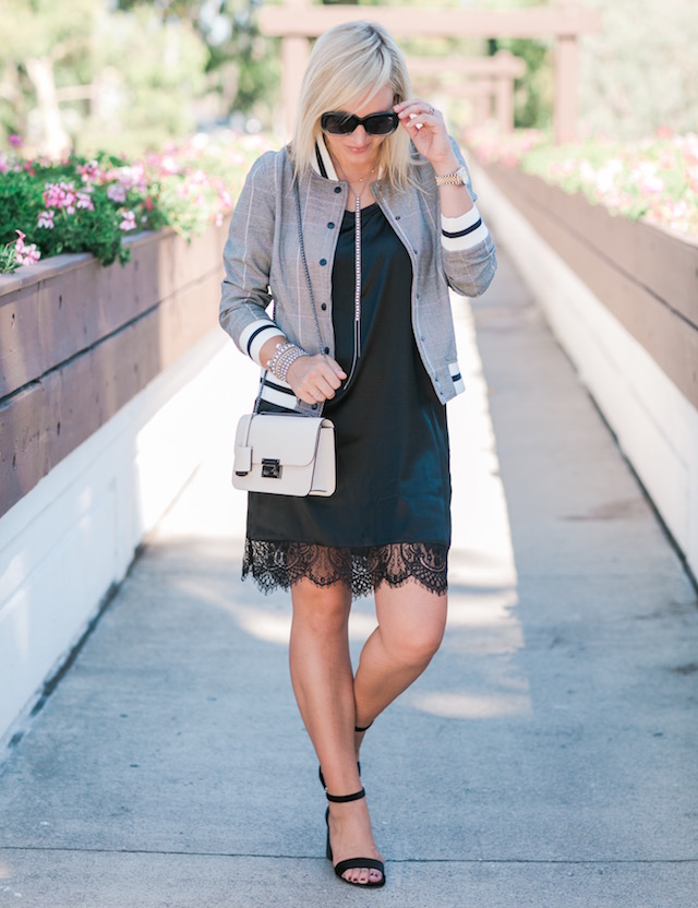 Fashion and lifestyle blogger Nikki Prendergast of My Style Diaries in a Who What Wear for TargetStyle Glen plaid bomber jacket with a Henri Bendel handbag.