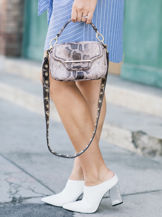 Fashion blogger Nikki Prendergast of My Style Diaries in Who What Wear white mules with a Henri Bendel handbag.