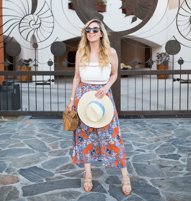 Vacation style with a cabi clothing midi skirt, Wayf crop top, Johnston & Murphy heels