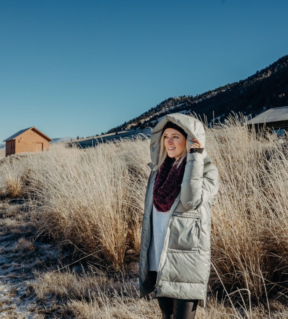 Carve Designs coat, Hunter boots, Free People scarf and hat, cold weather essentials in the National Elk Refuge in Jackson Hole, Wyoming.