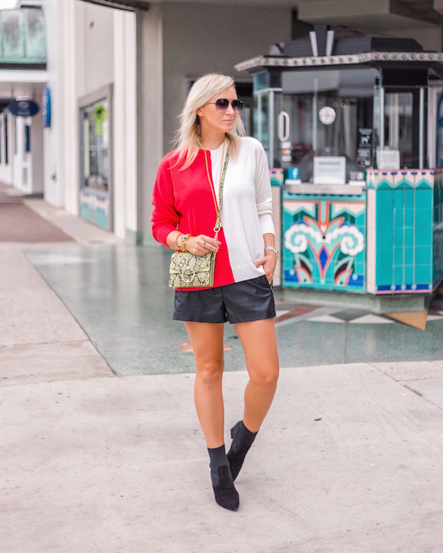 Leather shorts, sock booties, colorblocked sweater | My Style Diaries blogger Nikki Prendergast